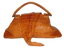 У ненатуральной кожи на срезе будет видна тканевая основа.  Также отличить сумку из натуральной кожи от подделок...